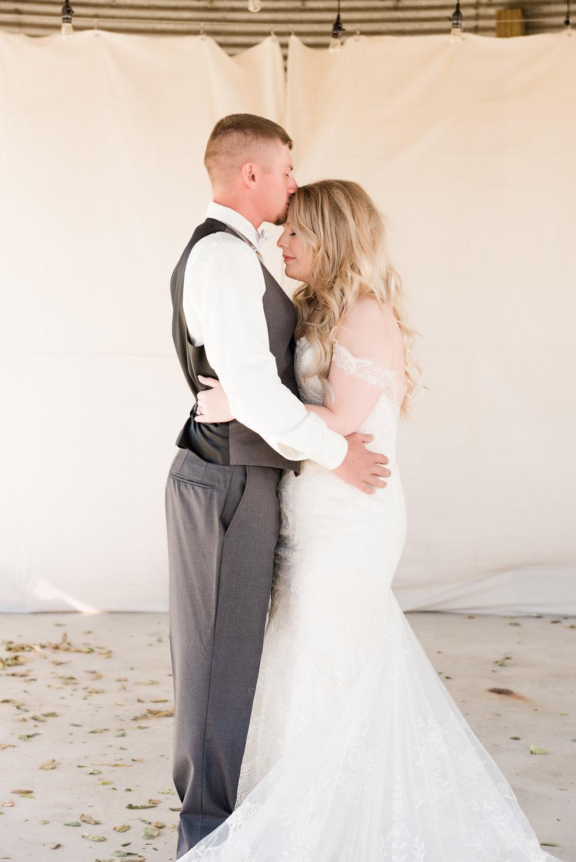 groom kissing forehead