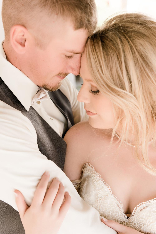 bride and groom eyes closed
