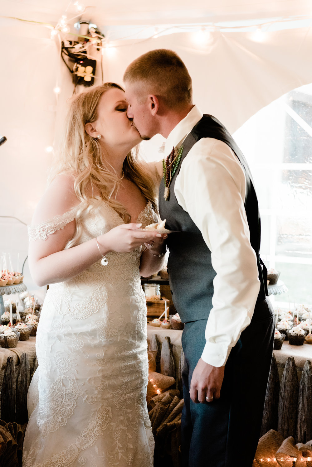 bride & groom kiss after cake cut