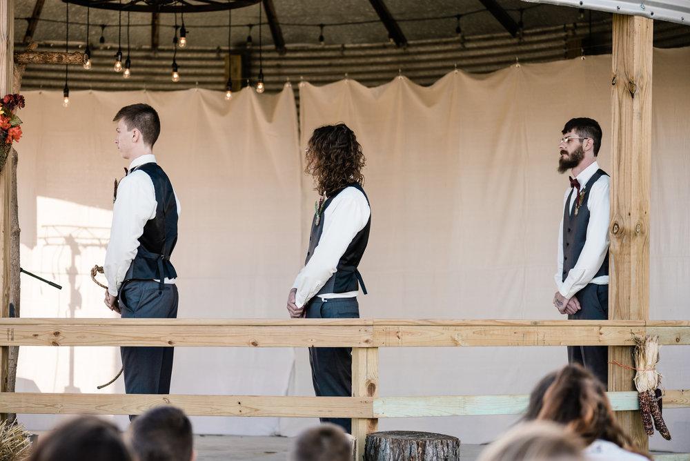groomsmen during ceremony