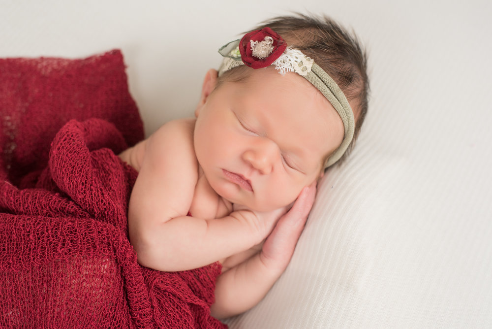 newborn girl in red