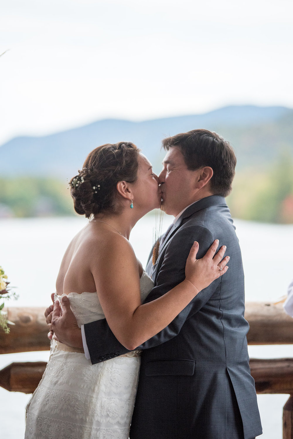 first-kiss-golden-arrow-lakeside-resort-lake-placid-ny-wedding-ym-photography