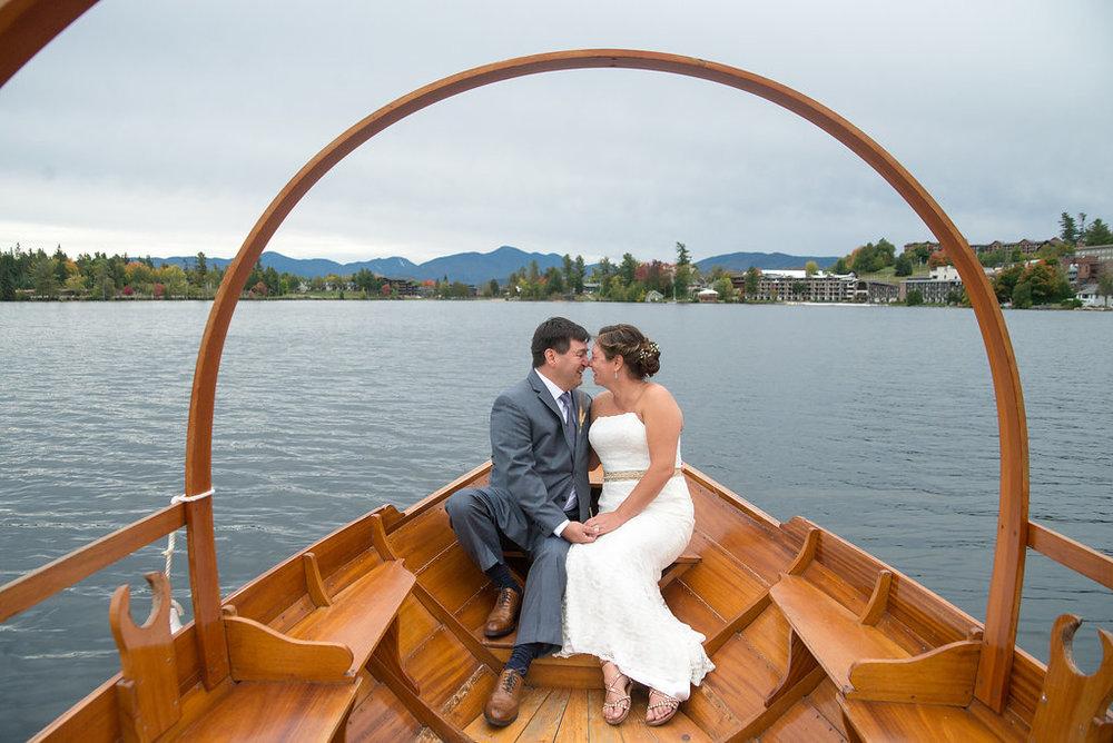 boat-mr-mrs-lake-placid-golden-arrow-lakeside-resort-lake-placid-ny-wedding-ym-photography
