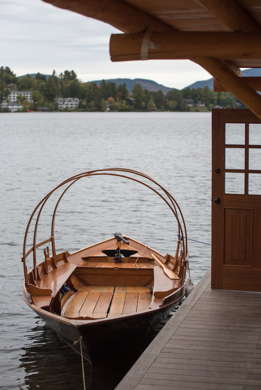 boat-on-the-water-golden-arrow-lakeside-resort-lake-placid-ny-wedding-ym-photography