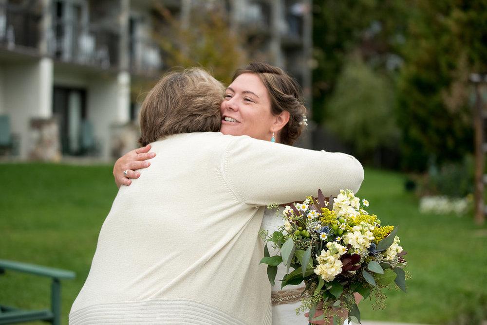 hugs-bride-golden-arrow-lakeside-resort-lake-placid-ny-wedding-ym-photography
