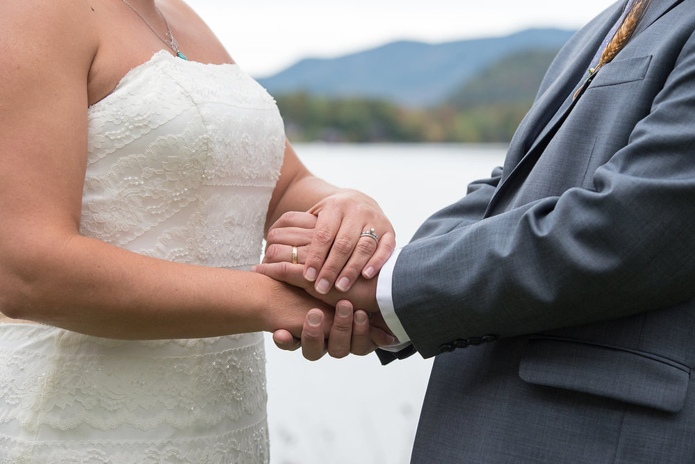bride-groom-holding-hands-golden-arrow-lakeside-resort-lake-placid-ny-wedding-ym-photography