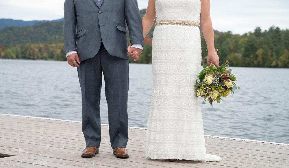 bride-groom-holding-hands-lake-golden-arrow-lakeside-resort-lake-placid-ny-wedding-ym-photography