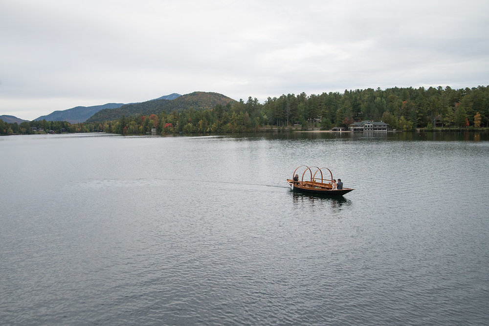 boat-on-the-water-lake-view-golden-arrow-lakeside-resort-lake-placid-ny-wedding-ym-photography