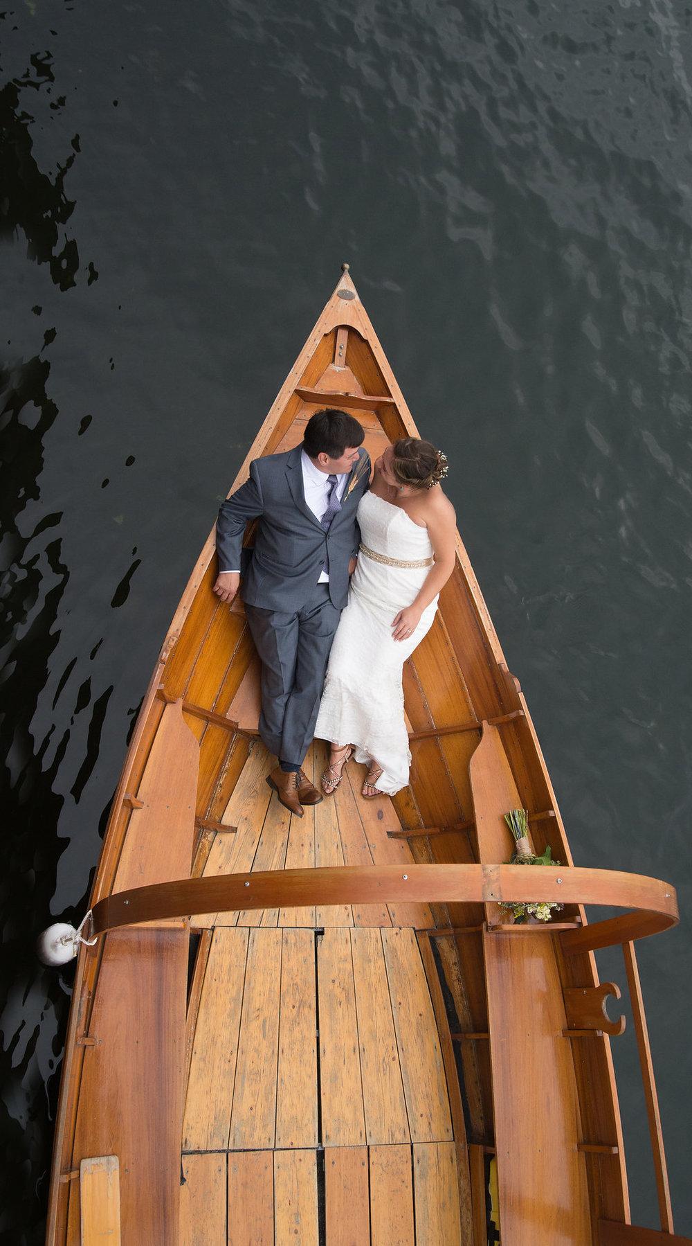 bride-groom-lake-boat-gondola-golden-arrow-lakeside-resort-lake-placid-ny-wedding-ym-photography