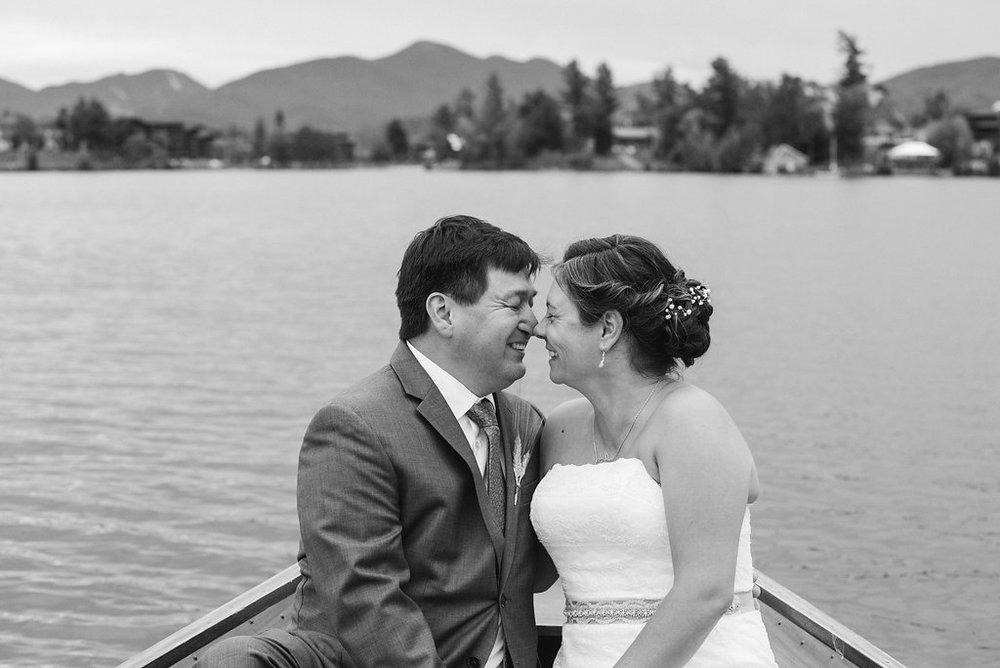 happy-couple-lake-boat-b&w-golden-arrow-lakeside-resort-lake-placid-ny-wedding-ym-photography