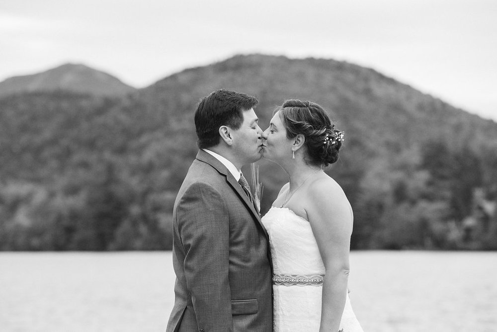bride-groom-kiss-golden-arrow-lakeside-resort-lake-placid-ny-wedding-ym-photography