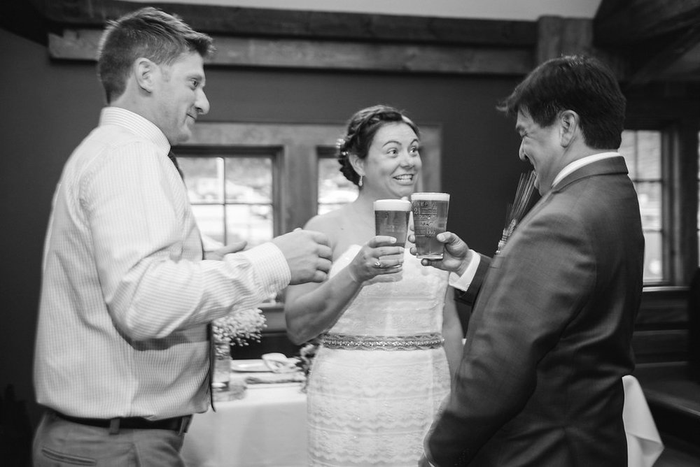 cheers-drinks-bride-groom-golden-arrow-lakeside-resort-lake-placid-ny-wedding-ym-photography