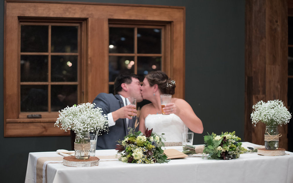kiss-bride-groom-reception-golden-arrow-lakeside-resort-lake-placid-ny-wedding-ym-photography