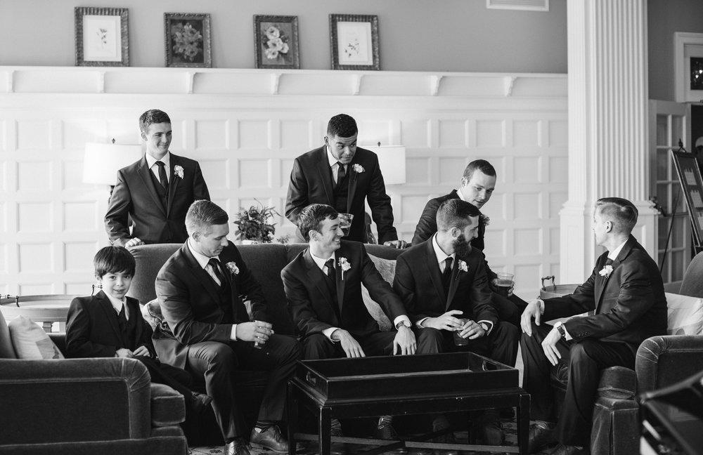 grooms-men-talking-sagamore-resort-lake-george-ny-wedding-ym-photography