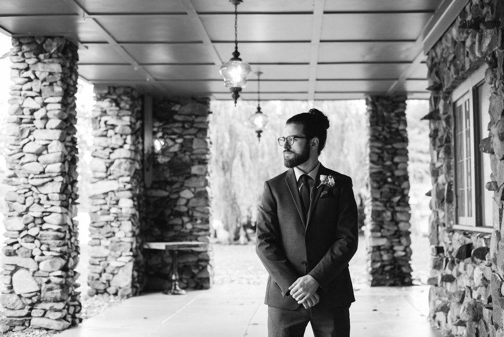 groom-first-look-portrait-old-daley-on-crooked-lake-ny-wedding-ym-photography