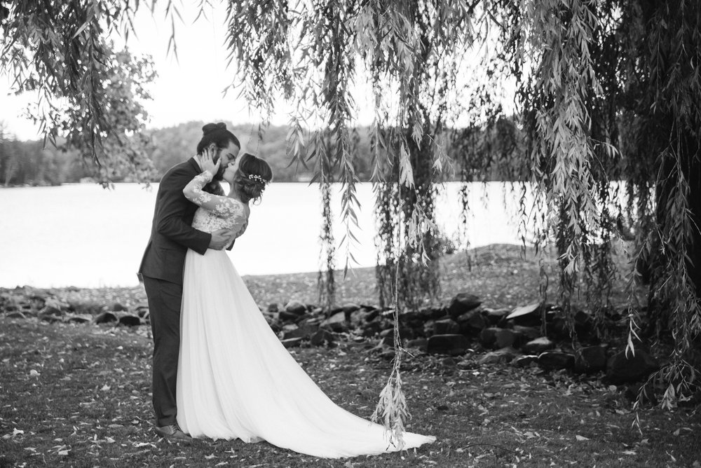 kiss-bride-and-groom-old-daley-on-crooked-lake-albany-ny-wedding-ym-photography