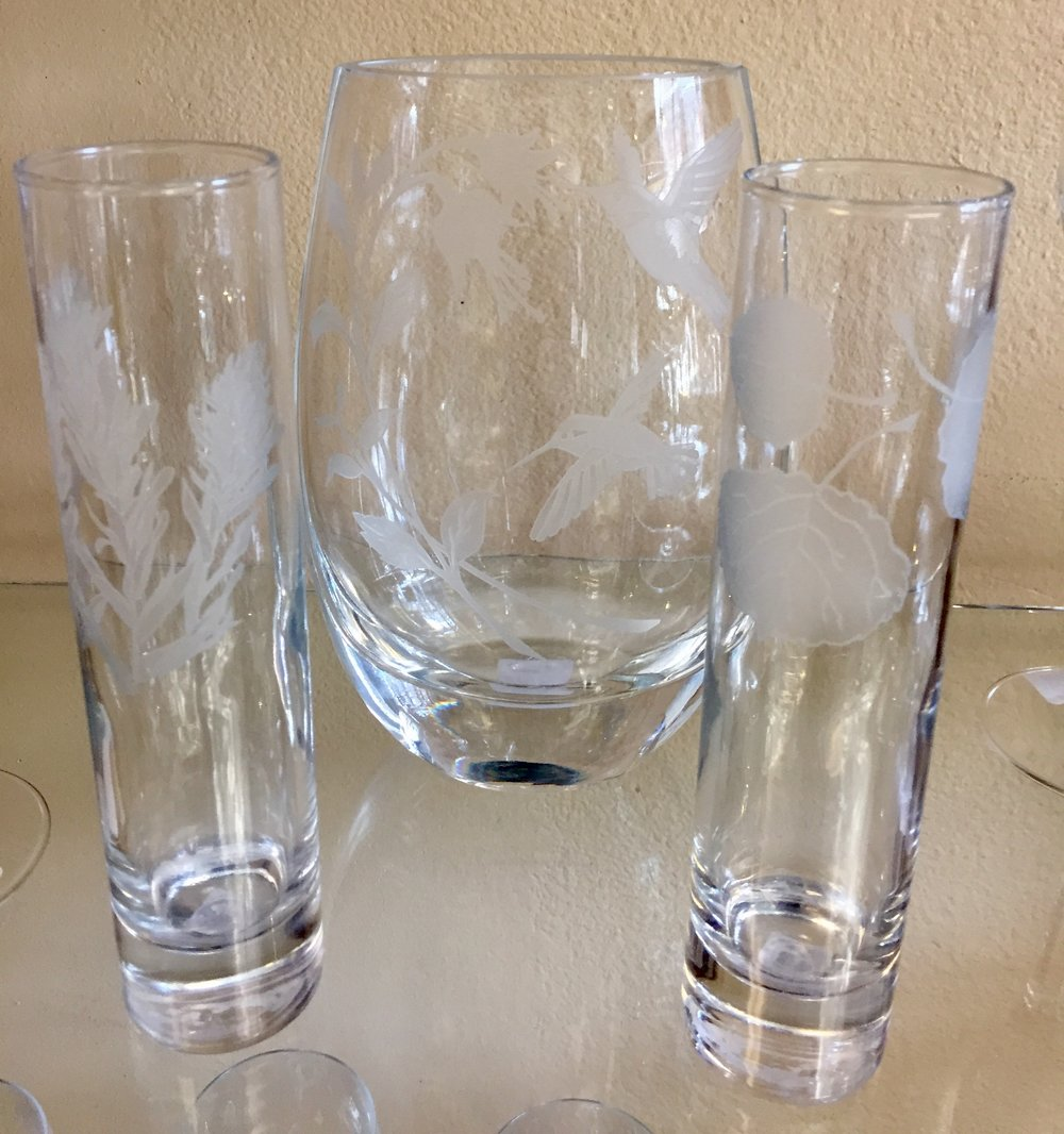 These crystal vases are hand-etched in Montrose, Colorado by artist Lorraine Coyle.