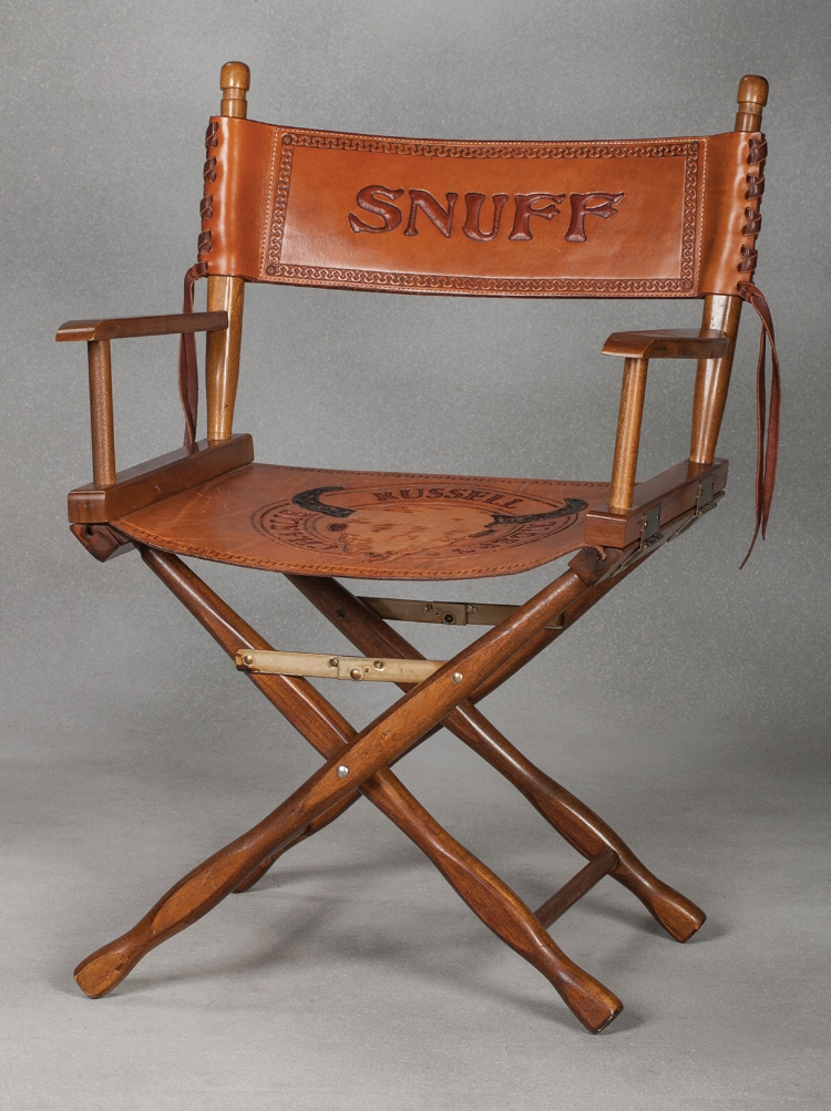 Snuff's custom Charlie Russell Riders Directors Chair. Estimate $800-1,400.