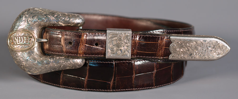 "Lot 83: Bohlinmade, Hollywood ""Snuff"" Buckle on Alligator Belt, Sold $1,180. Provenance: From the Estate of Snuff Garrett."