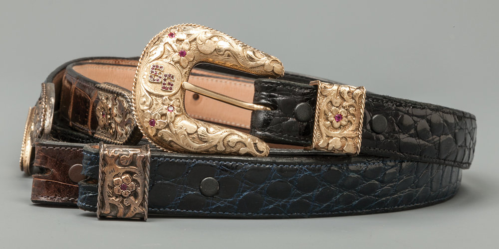 Lot 86: 18K Gold Edward H. Bohlin Buckle Set with Rubies, and Exotic Belts with Extra Tips, Sold $3,835. Provenance: From the Estate of Snuff Garrett