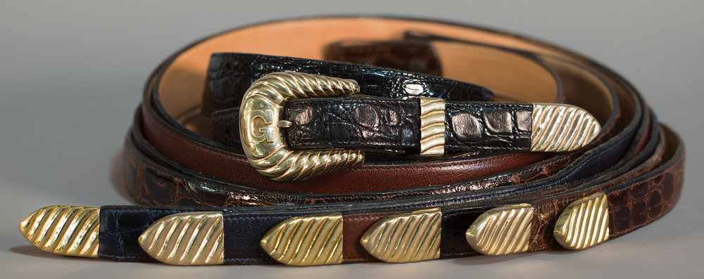 Lot 87: 14K & 18K Bohlin Buckle Set with Extras, Sold $3,835. Provenance: From the Estate of Snuff Garrett