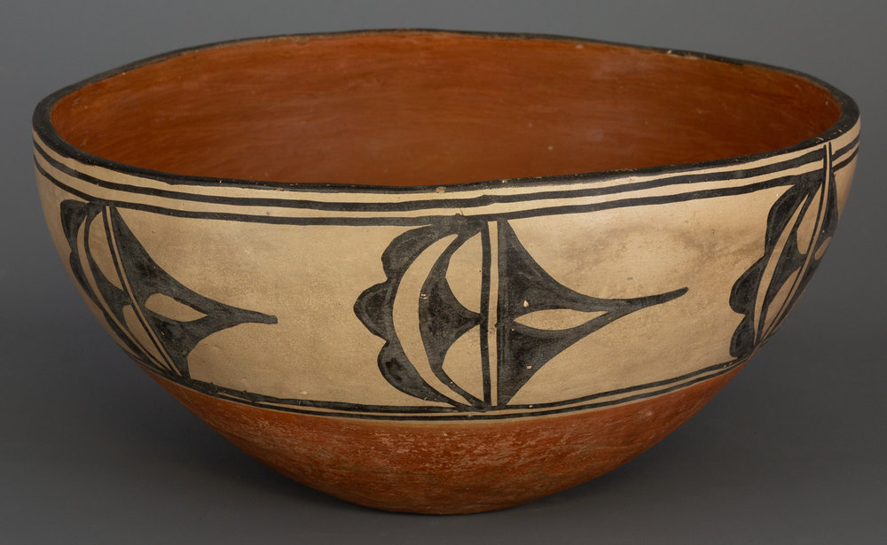 "Large Cochiti Dough Bowl Nice-sized Cochiti dough bowl, painted with traditional designs, with three black lines at the rim, two lines at the center, and red slip at bottom and interior. Circa 1920s-30s, 6 1/2"" x 12"".   Lot 182, Brian Lebel's Old West Auction - June 23rd, 2018, Santa Fe, NM. Estimate $1,500-1,800."