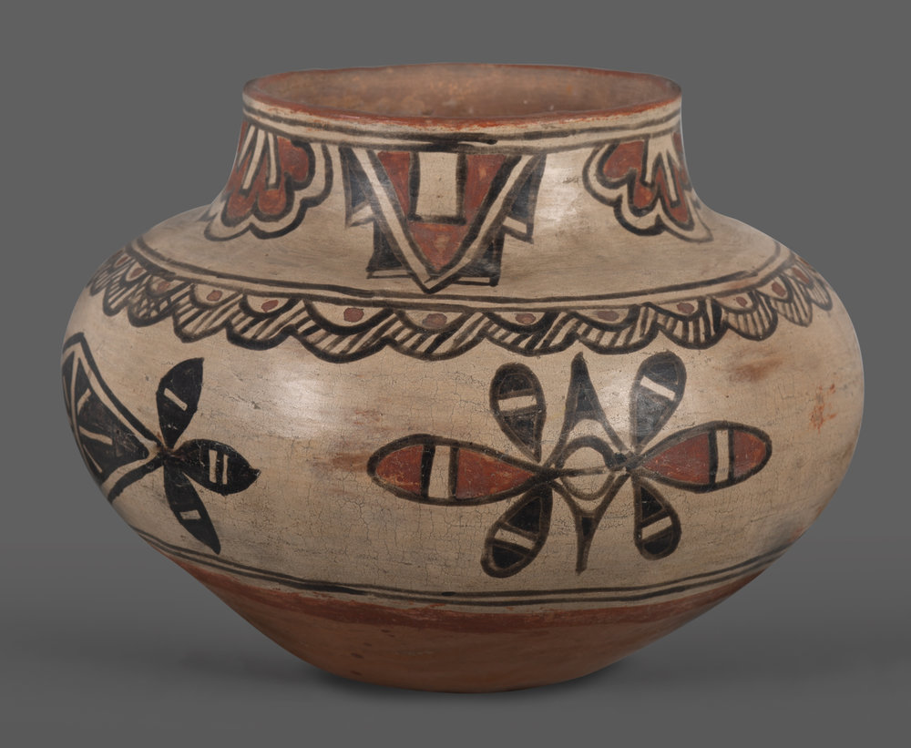 "Early San Ildefonso Pot An early polychrome San Ildefonso pottery jar. Geometric and floral designs are spaced throughout the body and around the rim. Nicely executed and painted. 9"" wide, 6 3/4"" tall. Circa 1900-1910.    Lot 183, Brian Lebel's Old West Auction - June 23rd, 2018, Santa Fe, NM. Estimate $2,000-2,500."