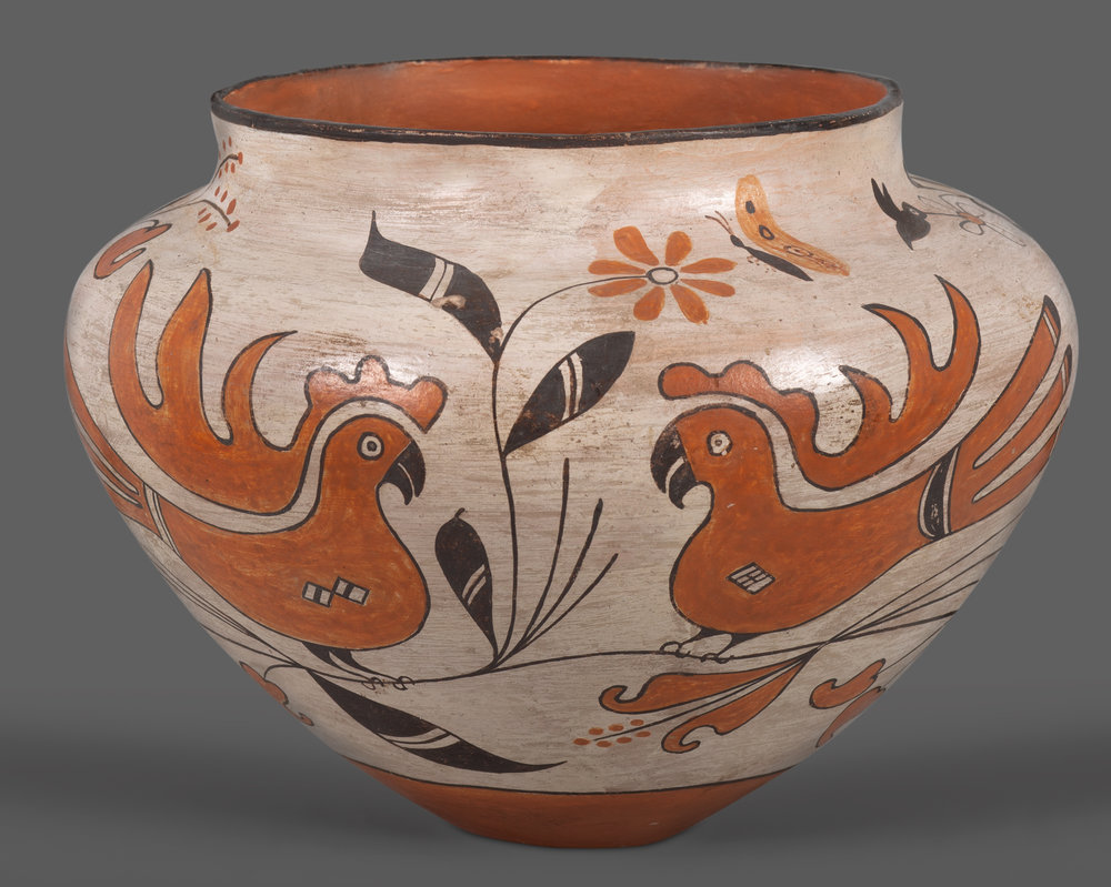 "Acoma Pottery Bowl or Jar A fine piece of Acoma pottery showcasing a black and orange design of two pairs of perched parrots, nestled between fauna, butterflies and even a single hummingbird, over a cream colored background. Well-executed and very attractive. Circa mid-20th century. 8 1/2"" across the shoulder, 6 1/2"" tall.   Lot 184, Brian Lebel's Old West Auction - June 23rd, 2018, Santa Fe, NM. Estimate $1,500-2,000."