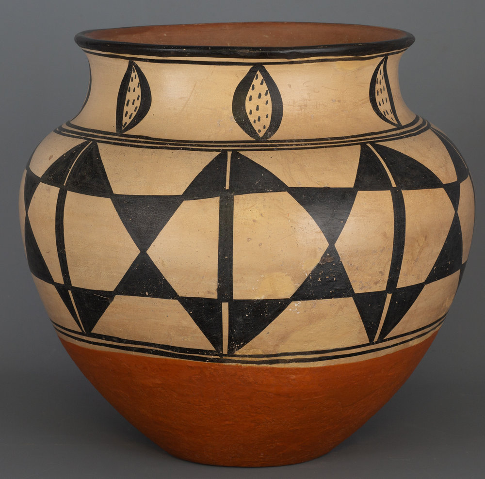 "Historic Santo Domingo Pottery Jar A classic Pueblo pottery storage jar with traditional Santo Domingo designs. Nicely shaped and executed, 14"" tall by 13"" wide. In excellent condition, from the Estate of Jose Reano, Governor of Santo Domingo Pueblo.  Provenance: Estate of Jose Reano to Margaret Kilgore to current owner.   Lot 185, Brian Lebel's Old West Auction - June 23rd, 2018, Santa Fe, NM. Estimate $8,000-10,000."