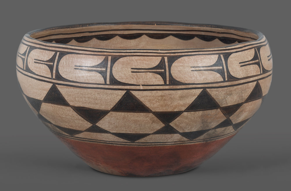 "Large Santo Domingo Dough Bowl by Effie Rosetta A massive Santo Domingo pottery bowl with interior and exterior classic black painted designs. Traditional cream slip and a red clay underbody. The outside design features a band of repeating stars capped with another band of repeating elements of a floral nature. The inside is quite unusual, with two large geometric devices facing one another, beneath a scallop-painted border. Signed ""effie"" and ""rosetta"" on opposite sides along the lower edge of the bowl, and ""S.D.P."" (for Santo Domingo Pueblo) is painted prominently on the bottom. An impressive 19"" wide by 9"" tall. Circa 1920s.  From Jack Slaughter, to current owner, with oral history that the bowl was acquired in approximately 1930 by John Bull & Co., Sheffield, England.   Lot 186, Brian Lebel's Old West Auction - June 23rd, 2018, Santa Fe, NM. Estimate $6,000-7,000."