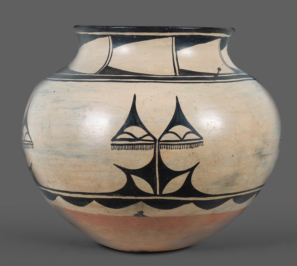 "Santo Domingo Pottery Jar A very large and well-executed Santo Domingo pottery jar. Interesting dark black quadrants of repeating geometric designs, buff colored clay, and a cream slip. It measures an exceptional 14 1/2"" at the shoulder, and 13 1/2"" tall. Circa 1900, from the Estate of Jose Reano. Provenance: Estate of Jose Reano to Margaret Kilgore to current owner.   Lot 187, Brian Lebel's Old West Auction - June 23rd, 2018, Santa Fe, NM. Estimate $8,000-10,000."