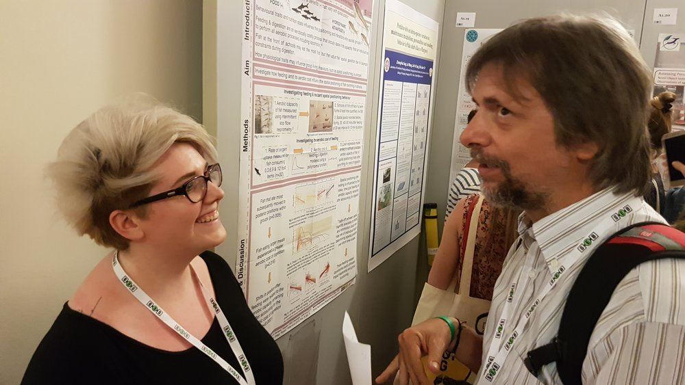 Steph McLean presenting her poster on how digestive costs affect schooling behaviour in fish.