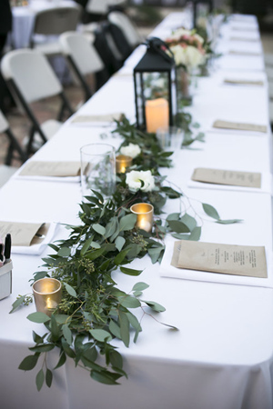 elegant-wedding-centerpiece-ideas-with-green-floral-and-lanterns.jpg