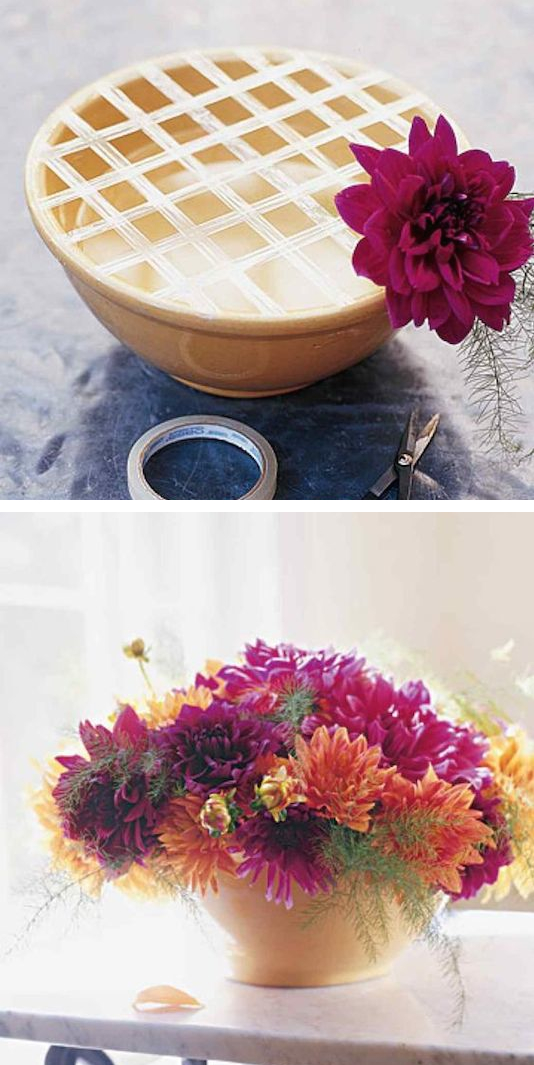 1.-Use-a-grid-of-tape-to-keep-your-flowers-in-place.-13-Clever-Flower-Arrangement-Tips-Tricks.jpg