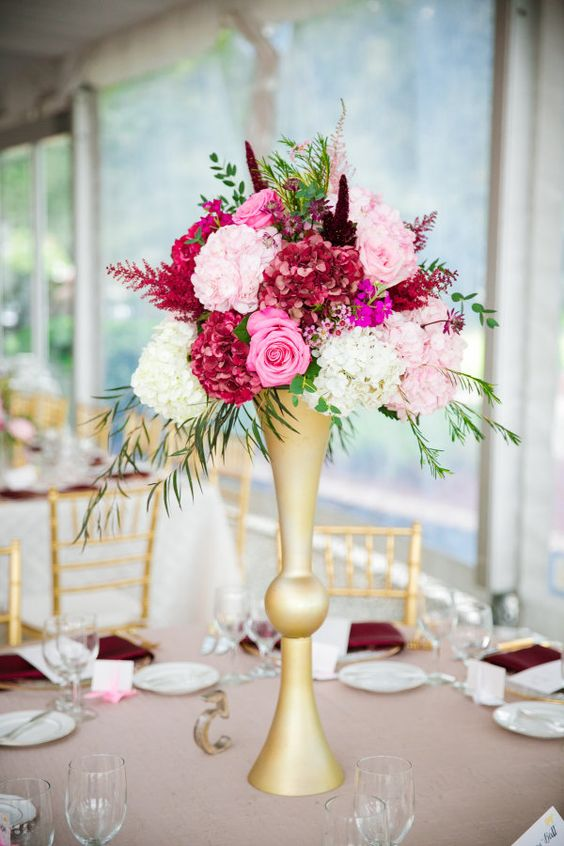 Towering-pink-wedding-floral-centerpiece-via-Dana-Cubbage-1.jpg