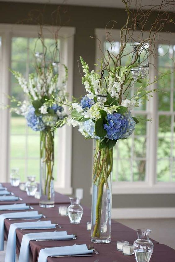 tall-rustic-centerpieces-look-beautiful-with-the-mixture-of-blue-green-white-and-brown-via-Jeff-Greenough-1.jpg