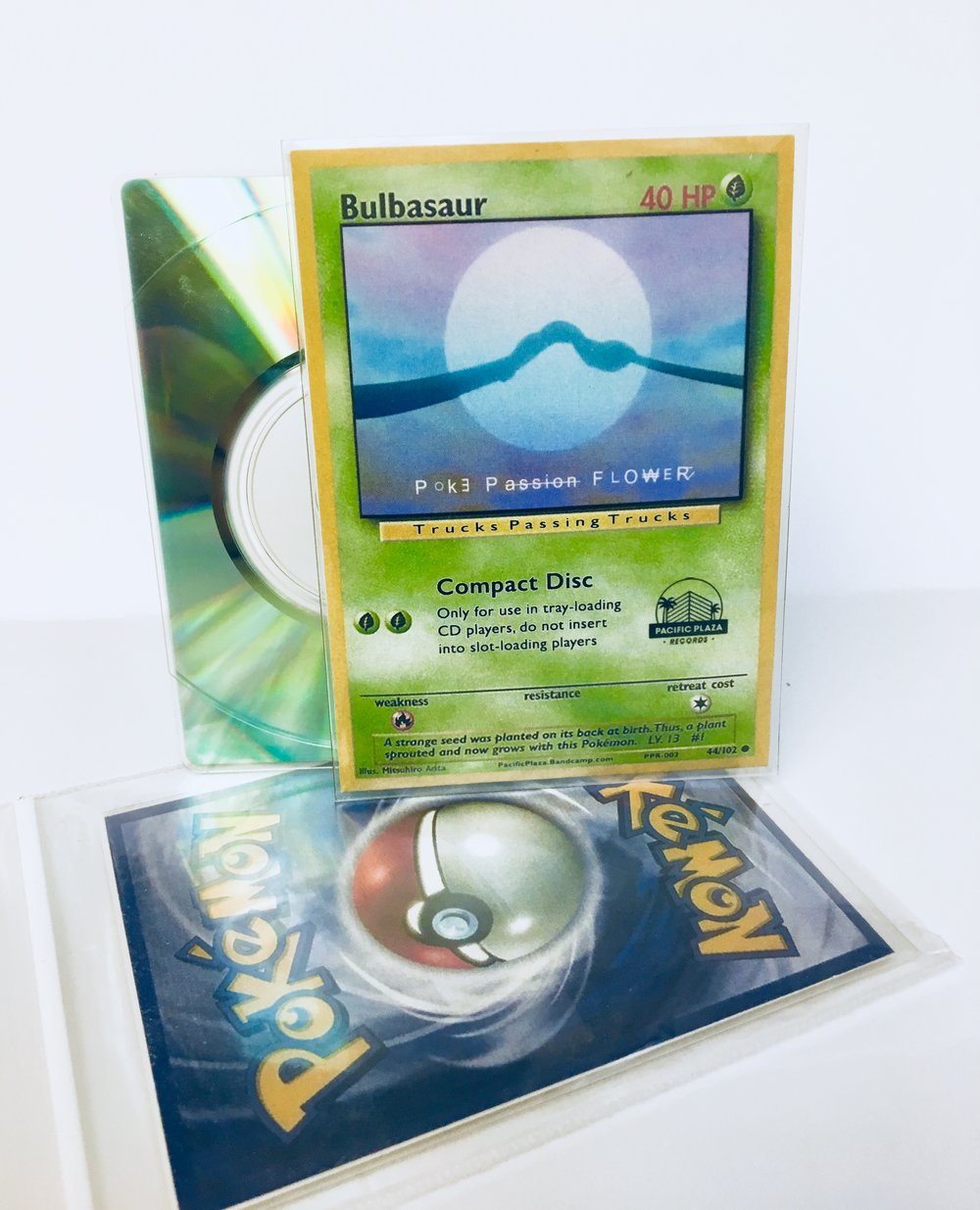 The creative packaging of Poke Passion Flower is a card shaped sleeve that houses a rectangular disc. When assembled, the release looks like a Pokemon card in a trading card sleeve.