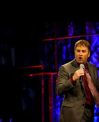 Brad Stine on stage.jpg