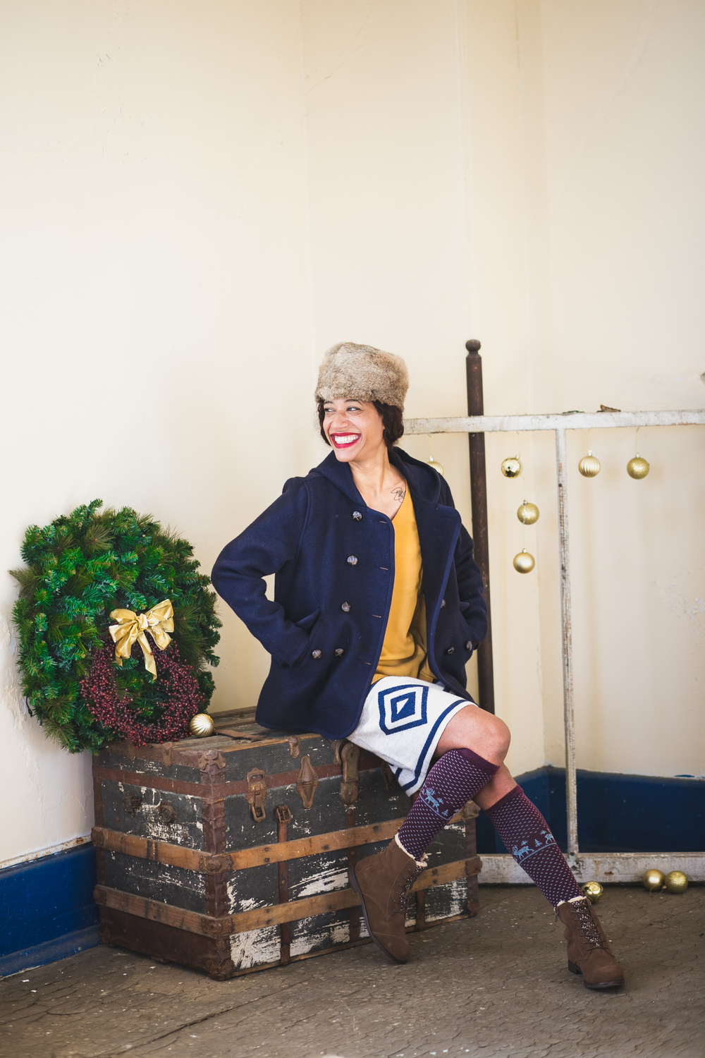 Look 3:    Top, Peanut Brittle; Olive & Oak   Diamond Sweater Skirt; Toad&Co   Century Wool Peacoat; Woolrich   Merino Lamb Socks; Woolrich   Alpa Boot, Chocolate Brown; TOMS   Fur Hat; CrownCap All items are available at Backwater Trading Company located in Edgartown