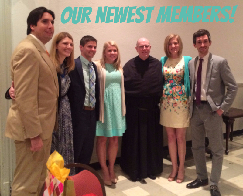 Becky, London, and Angela with their sponsors and fr. bill smile for a picture in Carr Hall during the reception after the Easter Vigil.