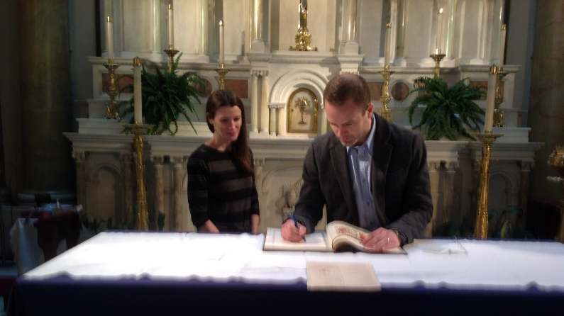 "JERRE RIGGS, CATECHUMEN, SIGNING THE ""BOOK OF THE ELECT"""
