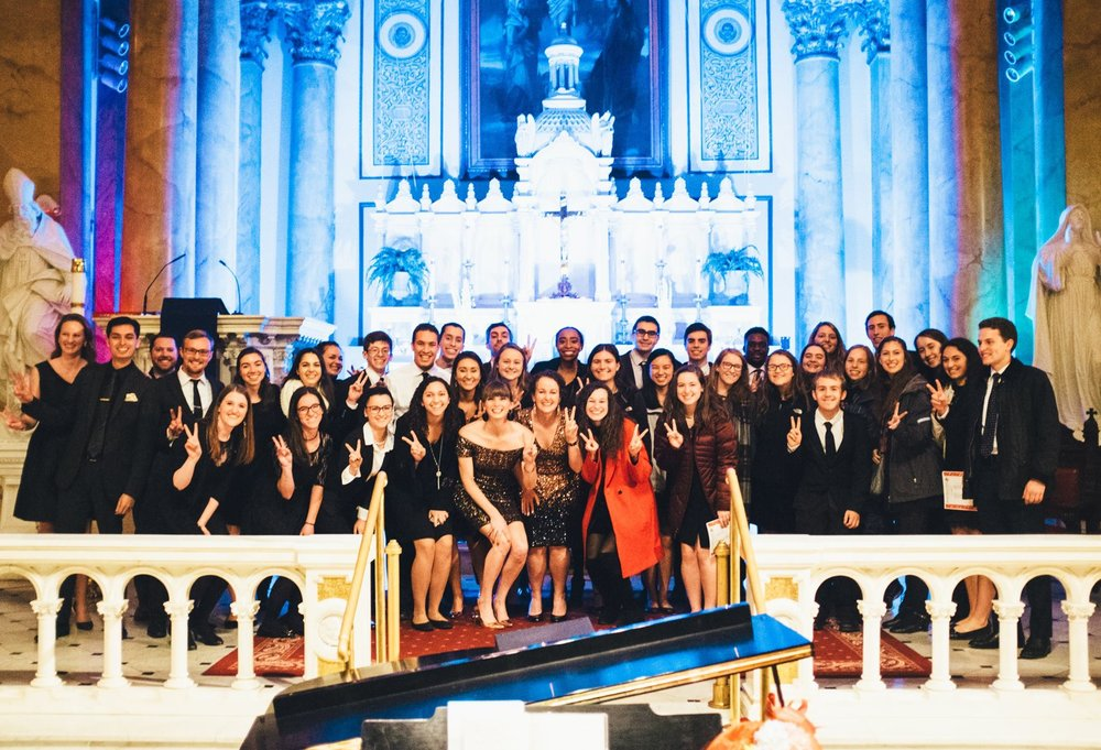 At our Christmas Concert on Saturday, many of the Chamber Choir members were alumni of the  Villanova Pastoral Musicians . The VPMs had been in Philly to sing Mass at the  Cathedral Basilica of Saints Peter & Paul  and came to  #RepeatTheSoundingJoy  afterward to support  Villanova University 's birthplace (and catch up with their alumni buddies!)  Here's a fantastic shot of our VPM alumni singers with the group of VPM singers and students!