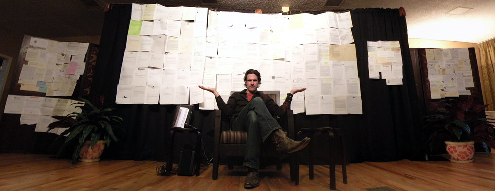 The photo is from the reading of my first book, in 2009, which took me 10 years to write and over 300 rejections to get published. The rejections -- all of them -- are up on the four walls behind me.