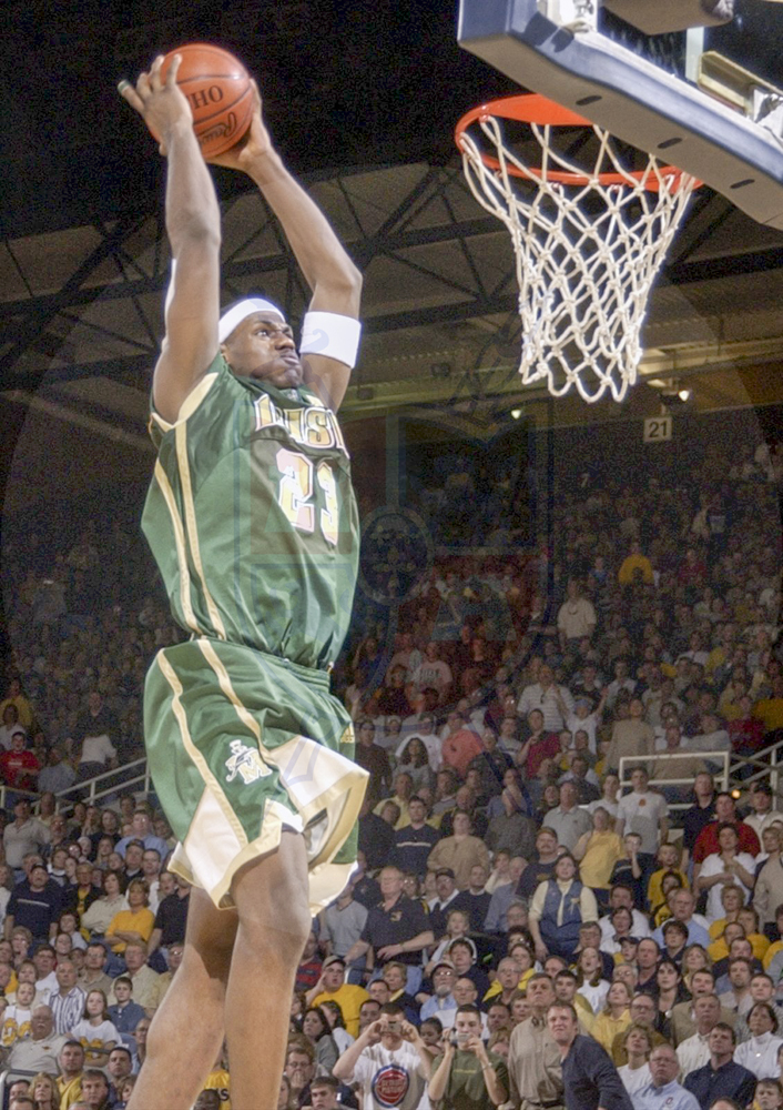On March 15, 2003, Akron St. Vincent-St. Mary Star LeBron James soars through the air for a dunk during second half action. James scored 25 points in their 69-59 win over Ottawa-Glandorf Saturday at Savage Hall.