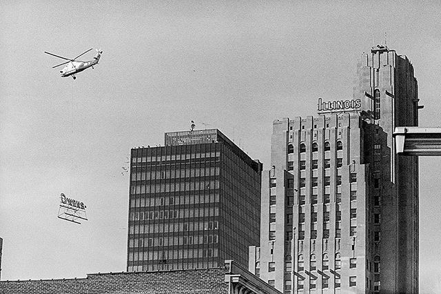 "#mondaymemories: ""O-I Moving Day""  As anyone who has moved knows, it works best if you move things one piece at a time. In this scan of a Blade archive photo taken by photographer Don Simmons, a helicopter hoists half of the landmark Owens-Illinois sign from its old headquarters in downtown Toledo on May 19, 1979. The Owens half of the sign was the first to be moved. The dismantling operation took more than an hour.  The sign had been part of the downtown Toledo skyline since 1955, and was flown to the nearby Middlegrounds for temporary storage. Parts of the logo were to be taken to Owens Technical College to serve as a symbol for that institution.  The proposal for a new Owens-Illinois Inc. headquarters and redevelopment of the northern half of downtown Toledo became public in July of 1977.  The project led to the birth of SeaGate Centre off Summit Street, along the Maumee River. Working closely with city of Toledo officials, Owens-Illinois announced its plans for a new headquarters at a cost of a minimum of $50 million.  The new headquarters, at One SeaGate, opened in 1981. On May 5, 2005, O-I announced it would leave downtown and relocate all of its local employees to an office park site it owned in Perrysburg. The 32-floor office tower in Toledo is now occupied by Fifth Third Bank.  #toledoblade #theblade #toledoohio #youwilldobetterintoledo #itmatterswhereyoumakeit #glasscity #history #nostalgia #toledo"