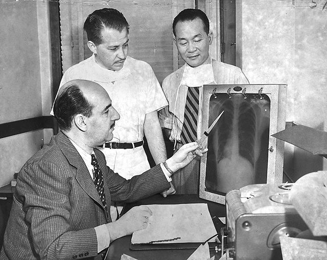 "#mondaymemories: ""Doctors wanted""  In the national arena, the issue of immigration has captured a lot of attention. Immigration status was also an issue in 1950, at least at one Toledo medical facility.  This Blade archive file photo, dated May 23, 1950, shows Dr. Phillip Cohn, left, and assistants, Dr. Jose Siero and Dr. Jack Wu, looking at a chest X-ray at the William Roche Memorial Hospital in Toledo.  The facility was referred to as a tuberculosis hospital and was having difficulty finding trained American chest doctors on its available budget. Few doctors specialized in chest diseases because of the comparatively low pay, making it necessary to hire foreign doctors. But Dr. Siero, from Nicaragua, and Dr. Wu, from China, were ruled ineligible to be staff physicians at the Roche Hospital.  The Ohio Civil Service commission determined that the two men could not be doctors at the facility because state law required staff members of a county institution to be both U.S. citizens and graduates of a Class A medical school eligible to be licensed in Ohio.  To get around the ruling, the hospital board designated the two men as ""medical secretaries"" reporting to Dr. Cohn, who was the hospital superintendent. The medical secretary position was a classification exempt from civil service oversight.  The hospital planned to ask other tuberculosis hospitals to join them in Columbus to address state lawmakers and ask to have the rules changed.  William Roche Memorial Hospital was funded by a 0.3-mill real estate tax levy. On average, it had 183 patients.  #toledoblade #theblade #toledoohio #youwilldobetterintoledo #itmatterswhereyoumakeit #glasscity #history #nostalgia #toledo"