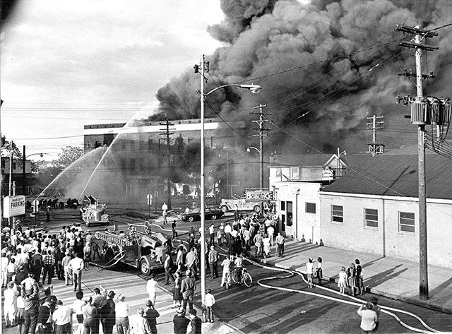 "#mondaymemories: ""Blaze destroys plumbing firm""  Fire destroyed a 12th Street building and 190 firefighters were needed to bring the roaring blaze under control on May 28, 1966.  The fire hit the three-story Heating, Trades Supplies, Inc. at Jackson and North 12th streets in Toledo. The black, billowing smoke attracted hundreds of onlookers, as shown in this Toledo Blade photo taken by Doug Moore. The thick smoke coming from the building's tar-paper roof hampered firefighters' efforts. The plumbing supply firm's loss was placed at $450,000.  The three-alarm late afternoon fire was accompanied by a series of small explosions and threatened a complex of structures at the edge of the downtown district. At midnight, 6½ hours after the blaze was reported, firefighters were still at the scene attempting to extinguish flames concentrated at the ground level. The three floors collapsed into the basement and strong winds fanned the flames. The building's contents consisted of mainly large inventories of plumbing and heating supplies and two delivery trucks.  The series of explosions was believed to have come from propane gas tanks used for plumbing and heating installations. Fire officials believed the fire started in a wooden structure adjoining the main building.  Two firemen were overcome by smoke and treated at area hospitals. Two children in the neighboring Child Study Institute also felt some effects from the smoke so that building was evacuated as a precaution. No serious injuries were reported.  #toledoblade #theblade #toledoohio #glasscity #history #nostalgia #toledo"