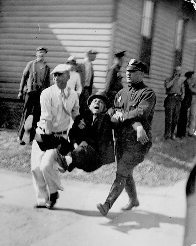 "#mondaymemories: ""Deadly Strike""  An initially peaceful protest was named ""Battle of Toledo"" once it became fatal. Nearly 85 years ago, a federal labor union of the American Federation of Labor began to strike against the Electric Auto-Lite company. An arrest of an organizer and four strikers initiated a five-day battle. During this battle, members of the Ohio National Guard and several thousand strikers clashed. Two strikers were shot down by National Guardsmen from a nearby bridge, and many others were injured. This photo shows a civilian and officer carrying a man near the Electric Auto-Lite plant during the strike.  The strike began on April 12, 1934, and ended on June 3, 1934. The historic strike, which was during the Great Depression, led to widespread unionization in Toledo and influenced federal laws allowing the right to unionize. It played a major role in the evolving United Automobile, Aerospace, and Agricultural Implement Workers of America. The 600,000-square-foot factory played an important part of Toledo history. It prospered after the strike until 1960 when Chrysler Corp. discontinued being a customer. Once closed, the factory suffered from multiple vandalism incidents.  #toledoblade #theblade #toledoohio #youwilldobetterintoledo #itmatterswhereyoumakeit #glasscity #history #nostalgia #toledo"