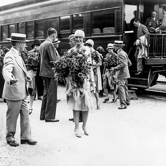 "#mondaymemories: ""Aviatrix Amelia Earhart visits Toledo""  On July 23, 1928, the City of Toledo flew into a tizzy with the arrival of famed aviatrix Amelia Earhart.  Earhart had received international acclaim only a month earlier when she became the first woman to fly across the Atlantic. The press had taken to calling her ""Lady Lindy"" — after aviation pioneer Charles Lindbergh — a nickname she disliked, but could never quite shake.  Seen shortly after arriving in Toledo in this Blade archive photo, the aviatrix was greeted at the train station with a bouquet of American Beauty roses. More than 100,000 Toledoans turned out to greet her during her stay in the Glass City, where she'd come to open the 12th National Exchange Club conference.  Toledo Mayor William T. Jackson decided to forgo the traditional glass key to the city. At a reviewing stand outside the Armory building after a miles-long parade, he presented Miss Earhart and her transatlantic cohorts (Wilmer Stultz and Lou Gordon) with a specially-struck medallion.  The celebrated aviatrix later met with delegates from the convention before returning to her train and departing for New York at 1 a.m. She was in Toledo for 15 hours.  On July 2, 1937 — less than a decade after her Toledo visit — Earhart entered the annals of infamy when she and her navigator, Fred Noonan, disappeared without a trace while trying to circumnavigate the globe.  To this day, researchers debate her fate.  #toledoblade #theblade #toledoohio #youwilldobetterintoledo #itmatterswhereyoumakeit #glasscity #history #nostalgia #toledo"