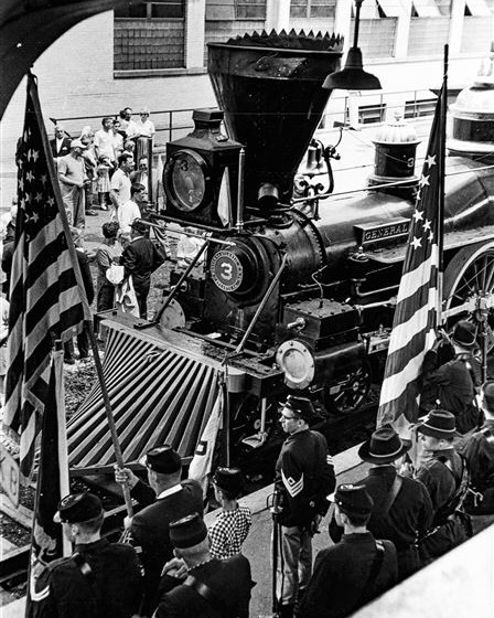 "#mondaymemories: ""The General' rolls into town""  It might seem impossible for a Civil War general to pay a visit to Toledo in the middle of the 20th century, but such was the case on Aug. 3, 1963.  On that date, the famed Civil War locomotive nicknamed ""The General"" rolled into the city for a visit, greeted by hundreds of people including the mayors of Toledo and three neighboring cities.  Pictured in this Blade archive photo from that day, which finds some in the crowd dressed in period costumes, ""The General"" holds a special place in the annals of Civil War exploits, and even has a strong connection to northwest Ohio.  On April 12, 1862, 19 Union soldiers disguised as civilians stole the steam-powered locomotive from Big Shanty, Ga., and made haste for the northern lines. Their goal was to destroy Confederate railroad tracks and bridges in their wake. Nine of those soldiers were from this region of Ohio.  They never made it to Union lines. After running out of fuel 90 miles into their escape, the soldiers abandoned the engine and fled into the Georgia woods. They were soon captured and tried as spies (thanks to their civilian clothes). Group leader James J. Andrews and nine of his men were hanged; others escaped or were freed in POW exchanges.  They would all later receive the Congressional Medal of Honor.  Severely damaged during the Union Army's 1864 march through Georgia, the engine was rescued from the scrap heap in 1891, restored, and later put on display at Union Station in Chattanooga, Tenn.  By the time of its Toledo visit the century-old vehicle was already the stuff of legend. As far back as 1926 comedian Buster Keaton had tried to rent the engine for a comedy he was making about the infamous theft. He was denied.  Among those in attendance at that 1963 visit was Robert C. Ward, grandson of Wilson W. Brown, the engineer for Andrews' Raiders during that 1862 heist.  Today, ""The General"" remains on permanent display at the Southern Museum of Civil War and Locomotive History in Kennesaw, Ga.  #toledoblade #theblade #toledoohio #youwilldobetterintoledo #itmatterswhereyoumakeit #glasscity #history #nostalgia #toledo #civilwar"